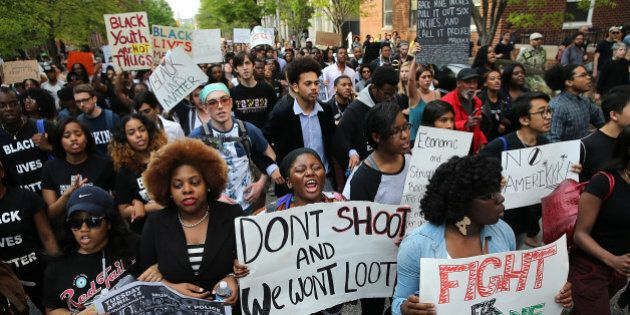 BALTIMORE, MD - APRIL 29: Students from Baltimore high schools and colleges march in protest chanting...
