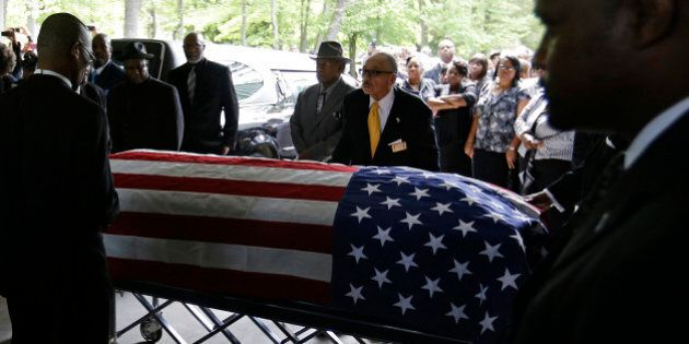 The casket of Walter Scott is wheeled into W.O.R.D. Ministries Christian Center for his funeral, Saturday,...