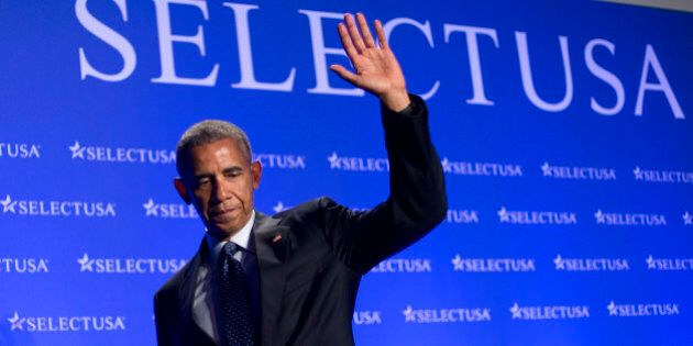 President Barack Obama waves as he walks off stage after speaking at the SelectUSA Investment Summit...