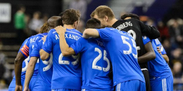 MONTREAL, QC - MARCH 28: Members of the Montreal Impact huddle prior to the start of the MLS game against...