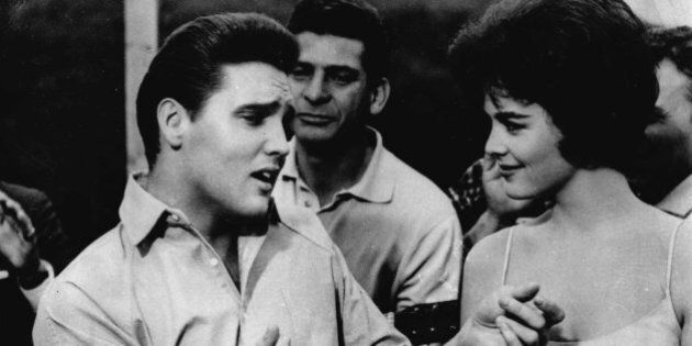 FILE - In this undated file photo, Elvis Presley, left, appears in a scene from the