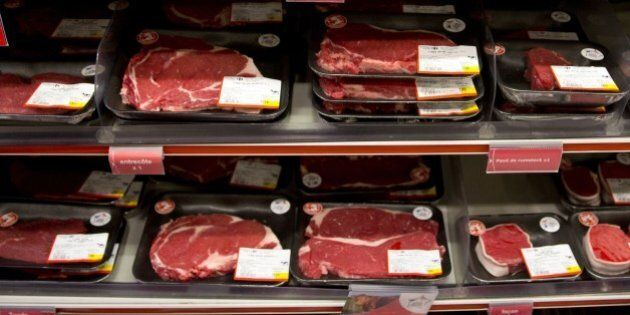 A sign reading 'French beef meat' is seen in front of meat products in a supermarket during a visit of the French minister of agriculture as part of the 'Viandes de France' (French meat) national day on August 25, 2015 in Paris. AFP PHOTO / KENZO TRIBOUILLARD        (Photo credit should read KENZO TRIBOUILLARD/AFP/Getty Images)