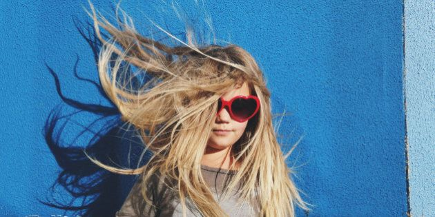Portrait of a young girl with long hair blowing in the