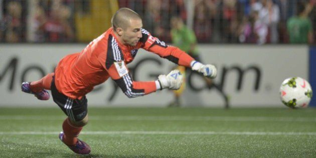 Impact of Montreal Goal Keeper Evan Bush defends against Liga Deportiva Alajuelense during their Concacaf...