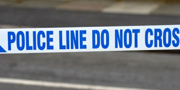 A generic stock photo of police tape outside a murder scene in Wallasey,