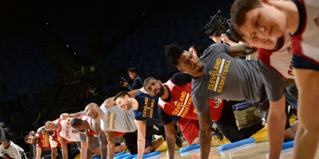 OAKLAND, CA - JUNE 18: The Cleveland Cavaliers stretch during practice and media availability as part...