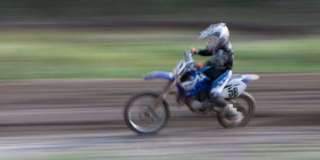 Person riding motocross bike