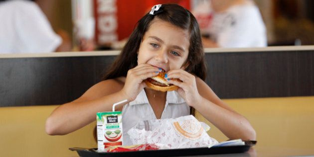 Paolo Beldran eats a healthy choice meal at a south Miami Burger King Tuesday, July 12, 2011.  Parents seeking healthier restaurant meals for their kids  At least 19 large restaurant chains _ including Burger King, Chili's, IHOP and Friendly's _ plan to announce Wednesday that they will add healthier options to their children's menus. At least 15,000 restaurant locations will focus on increasing servings of fruits and vegetables, lean proteins, whole grains and low fat dairy. The new items will have less fats, sugars and sodium. (AP Photo/J Pat Carter)