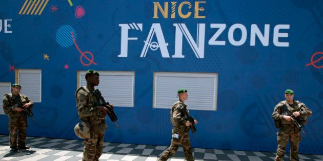 Soldiers patrol outside a fan zone ahead of the UEFA 2016 European Championship in Nice, France, June...