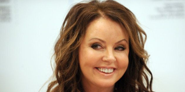 Famed Britishsinger Sarah Brightman smiles during her press conference in Moscow on October 10, 2012....