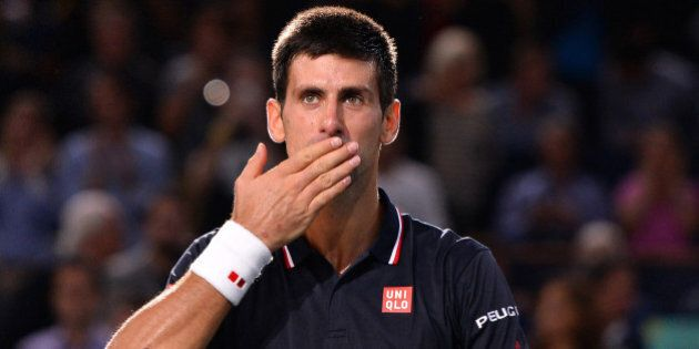 PARIS, FRANCE - NOVEMBER 02: Novak Djokovic of Serbia celebrates after victory against Milos Raonic of...