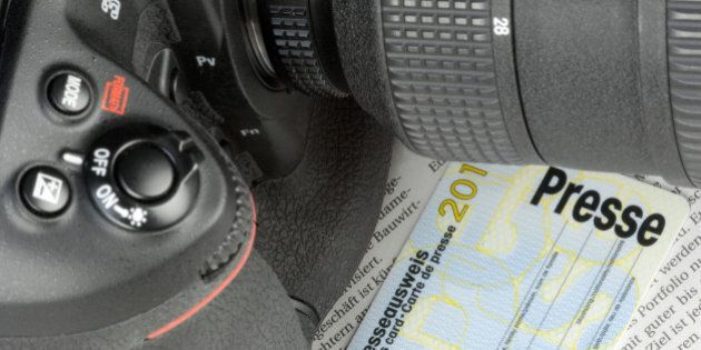 Camera and press