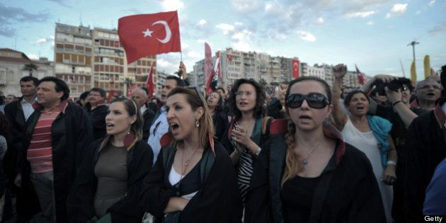 Anti goverment protestors and members of Izmir lawyers association chant slogans during a demonstration...
