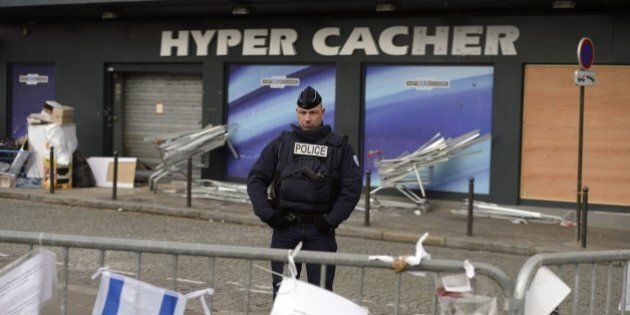 A policeman stands guards, on January 21, 2015 in front the Hyper Cacher kosher supermarket where jihadist...