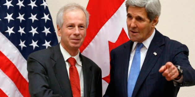 Canadian Foreign Minister Stephane Dion, left, meets with U.S. Secretary of State John Kerry alongside...