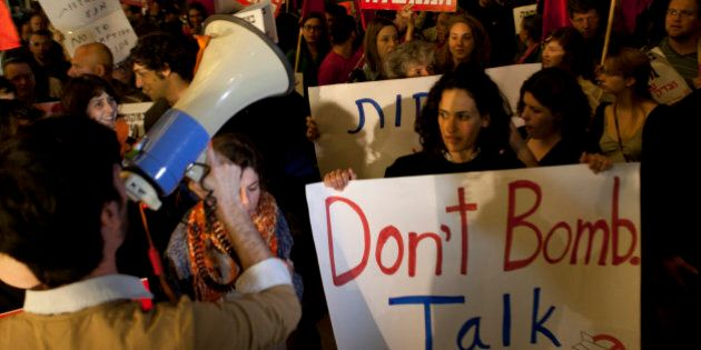 Israelis, social protesters and left wing activists march against the possibility of an Israeli strike...