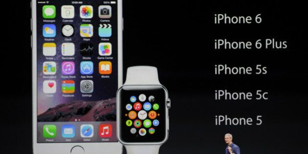 Tim Cook, chief executive officer of Apple Inc., talks about the new iPhone 6 and Apple Watch during a product announcement at Flint Center in Cupertino, California, U.S., on Tuesday, Sept. 9, 2014. Apple Inc. unveiled redesigned iPhones with bigger screens, overhauling its top-selling product in an event that gives the clearest sign yet of the company's product direction under Cook. Photographer: David Paul Morris/Bloomberg via Getty Images