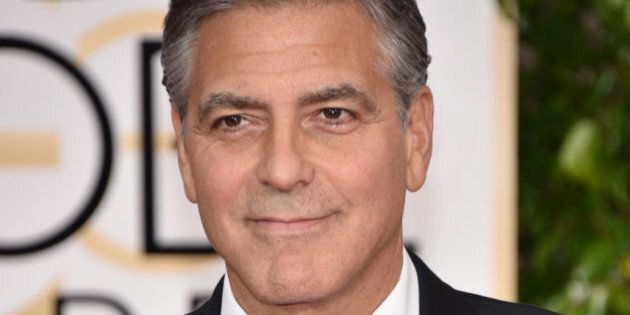 George Clooney wears a buttong