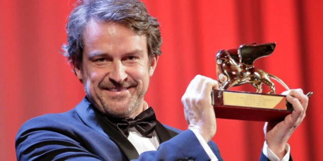 Director Lorenzo Vigas receives the Golden Lion for best film for 'Desde Alla' (From afar) during the...