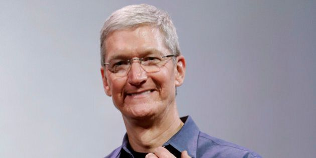 Apple CEO Tim Cook, holding an IPhone 6 Plus, discusses the new Apple Watch and iPhone 6s on Tuesday,...