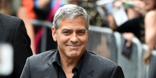 TORONTO, ON - SEPTEMBER 11: Producer George Clooney attends the 'Our Brand is Crisis' premiere during...