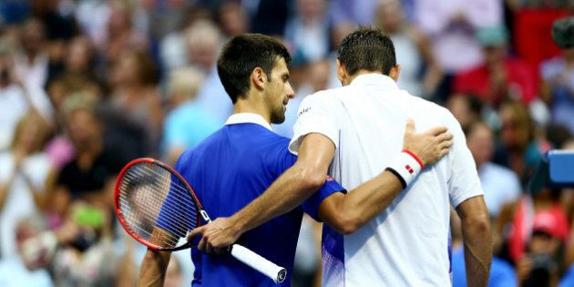 NEW YORK, NY - SEPTEMBER 11: Novak Djokovic (L) of Serbia embraces Marin Cilic of Croatia after defeating...