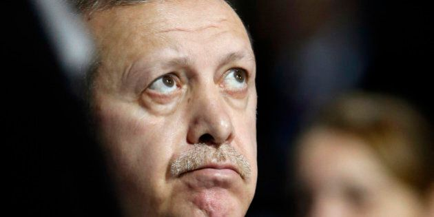 Turkey's President Recep Tayyip Erdogan listens to statements at the COP21, United Nations Climate Change...