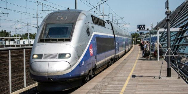 Passengers wait to board a TGV duplex high-speed train, operated by Societe Nationale des Chemins de...