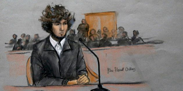 In this courtroom sketch, Boston Marathon bombing suspect Dzhokhar Tsarnaev is depicted sitting in federal...