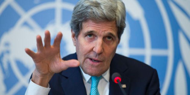 Secretary of State John Kerry gestures during a news conference after he delivered remarks to the United...