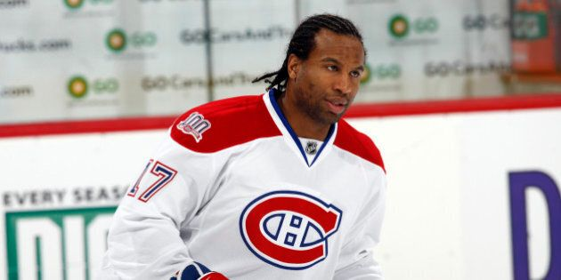 Montreal Canadiens right winger George Laraque warms up before facing the Colorado Avalanche in the first...