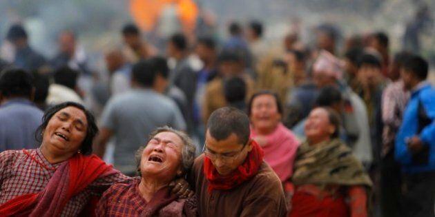 Family members break down during the cremation of earthquake victims inBhaktapur near Kathmandu, Nepal,...
