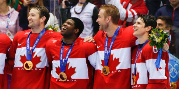 Canada forward Sidney Crosby, far right, stands with teammates for the Canadian national anthem after beating Sweden 3-0 in the men's gold medal ice hockey game at the 2014 Winter Olympics, Sunday, Feb. 23, 2014, in Sochi, Russia. (AP Photo/Julio Cortez)
