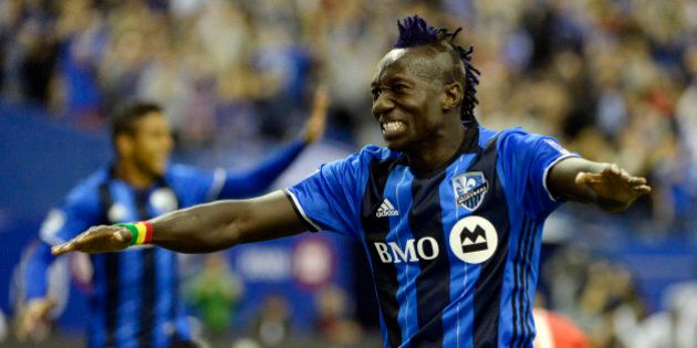 Mar 12, 2016; Montreal, Quebec, CAN; Montreal Impact forward Dominic Oduro (7) celebrates after scoring a goal against the New York Red Bulls during the second half at the Olympic Stadium. Mandatory Credit: Eric Bolte-USA TODAY Sports