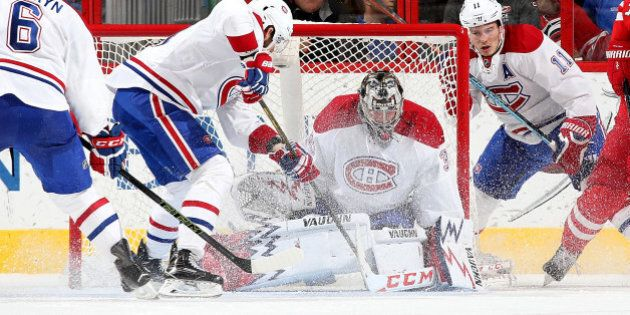RALEIGH, NC - APRIL 07: Charlie Lindgren #35 of the Montreal Canadiens goes down in the crease to protect...
