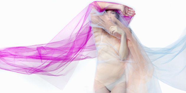 woman covered with bright material