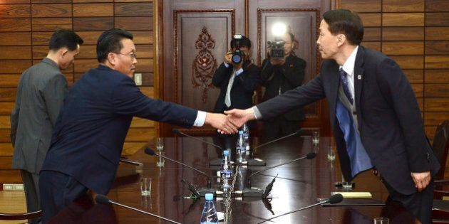 In this photo provided by the South Korean Unification Ministry, South Korea's chief delegate Kim Kiwoong,...