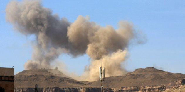 In this photo take on Friday, April 17, 2015, smoke rises after a Saudi-led airstrike on Sanaa, Yemen....