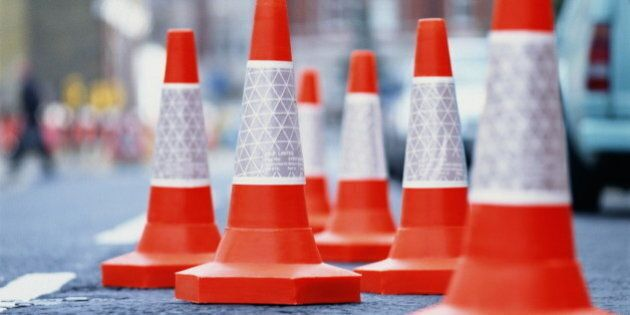 Traffic cones in middle of urban street,