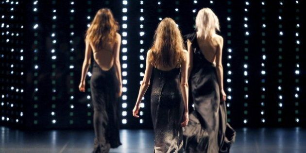 Models present creations for Saint Laurent Spring/Summer 2016 women's ready-to-wear collection during...