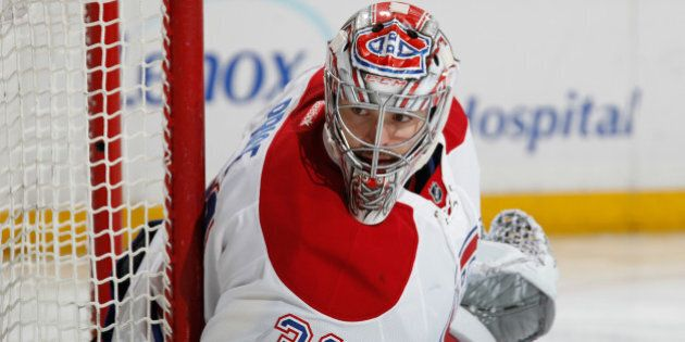 NEW YORK, NY - NOVEMBER 25: Carey Price #31 of the Montreal Canadiens tends the net against the New York...