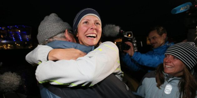 Quebec rower Mylene Paquette, center, is welcomed by her father, Jean, left, and her sister, Evelyne,...