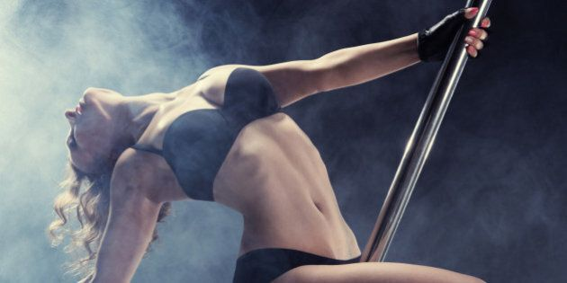 Sport. Pole dancer, woman dancing on