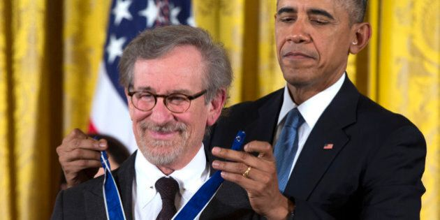 President Barack Obama, right, presents the Presidential Medal of Freedom to Steven Spielberg during...