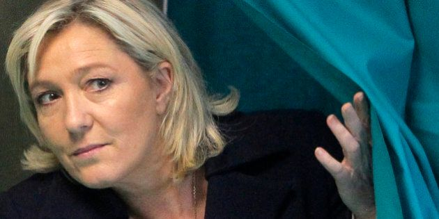 FILE - This Sunday, March 29, 2015 file photo shows French far-right leader and National Front Party,...