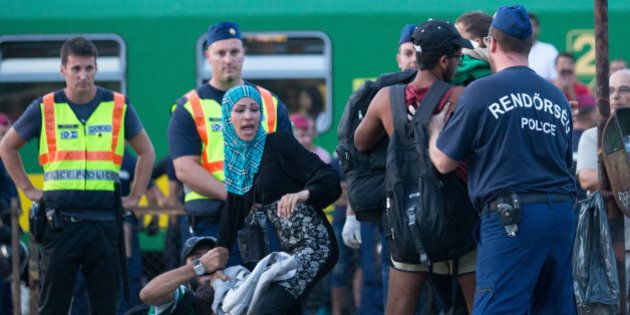 BUDAPEST, HUNGARY - SEPTEMBER 03:  Migrants protest against being taken to a refugee camp from a train that has been held at Bicske station on September 3, 2015 in Bicske, near Budapest, Hungary. Although the station has reopened, all international trains to Western Europe have been cancelled. According to the Hungarian authorities a record number of migrants from many parts of the Middle East, Africa and Asia are crossing the border from Serbia. Since the beginning of 2015, the number of migrants using the so-called Balkans route has exploded with arrivals in Greece from Turkey, and then travelling on through Macedonia and Serbia before entering the EU via Hungary. The massive increase, said to be the largest migration of people since World War II, led Hungarian Prime Minister Victor Orban to order Hungary's army to build a steel and barbed wire security barrier along its entire border with Serbia, after more than 100,000 asylum seekers from a variety of countries and war zones entered the country so far this year.  (Photo by Matt Cardy/Getty Images)