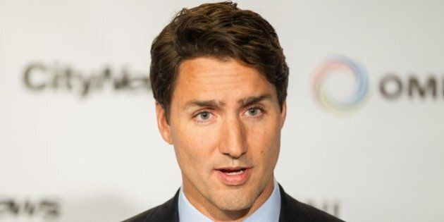 Liberal leader Justin Trudeau speaks to reporters during a press conference following the first federal...
