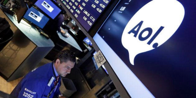 Specialist Ronnie Howard works at his post on the floor of the New York Stock Exchange, Tuesday, May...
