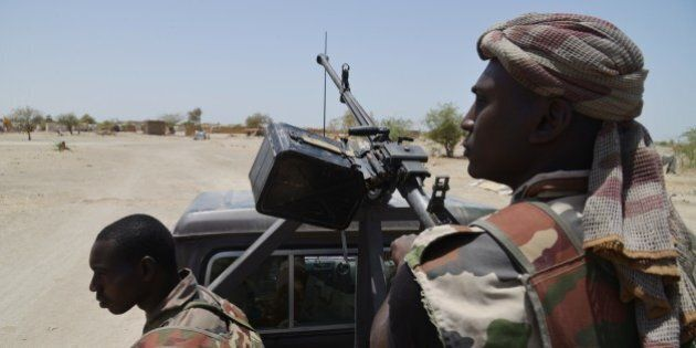 Nigerien soldiers patrol along the Nigerian border, near the south-eastern city of Bosso, on May 25,...