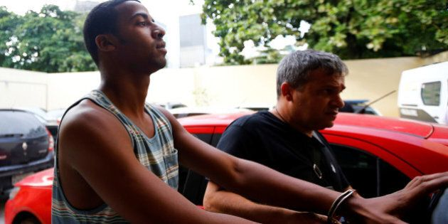 Rai de Souza (L), 22, suspected of being involved in the gang rape of a teenage girl, with a video of...